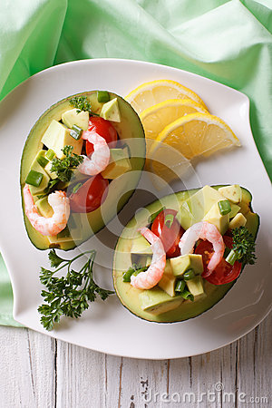 Free Avocado Filled With Shrimp Salad And Vegetables Closeup. Vertical Stock Images - 59311074