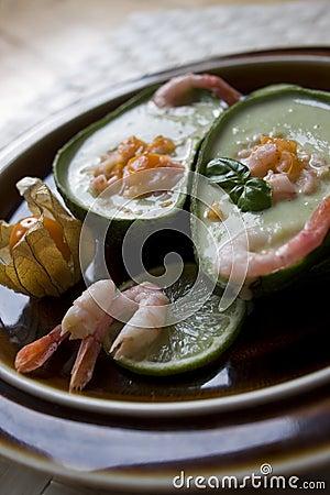 Avocado soup with physalis-shrimp salsa