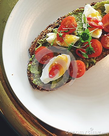 Free Avocado Toast On Plate With Soft-boiled Egg, Cherry Tomatoes, Cilantro Royalty Free Stock Photos - 79226368
