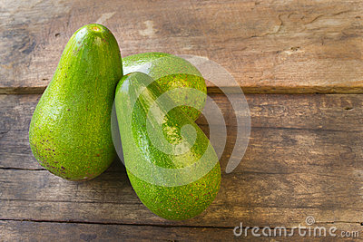 Avocado on wood background