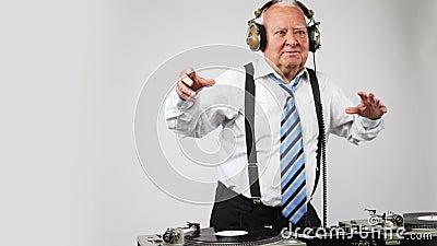 Awesome grandpa DJ. A very funky elderly grandpa dj mixing records