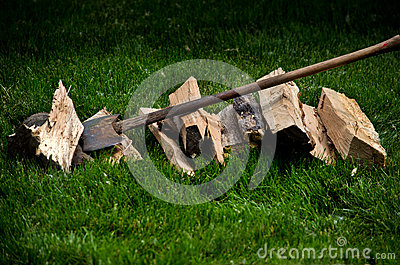 Axe and pile of wood