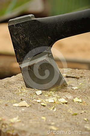 Axe in wooden block