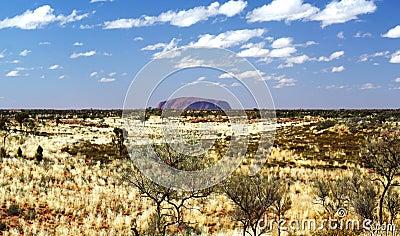 Ayers Rock Uluru and Cloudy Sky Editorial Photography