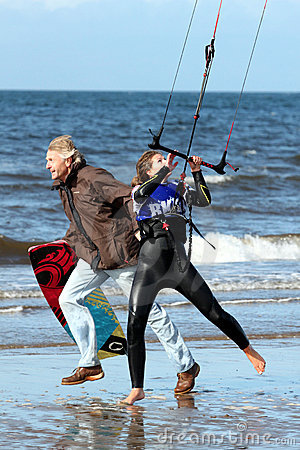 Ayr Kiteival Festival 2011 running the kite upwind Editorial Photo