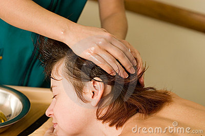 Ayurvedic oil massage of the scalp