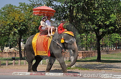 Ayutthaya, Thailand:  Visitors Riding an Elephant Editorial Stock Photo