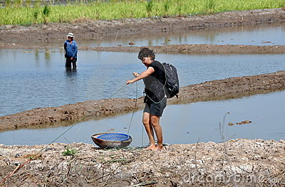 Ayutthaya, Thailand: Woman with Basket Fishing Editorial Stock Photo