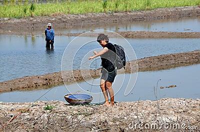 Ayutthaya, Thailand: Woman with Basket Fishing Editorial Stock Photo