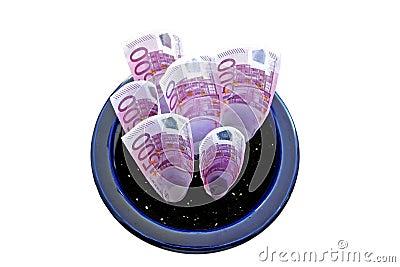 Bündel von 500 Euroanmerkungen, die in einem Potenziometer wachsen