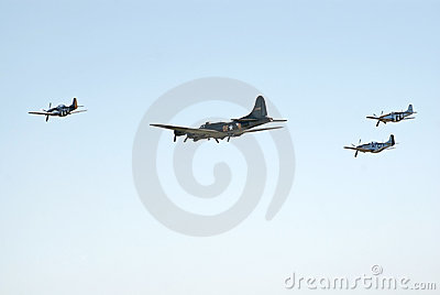 B-17 and three P-51 s fly in formation Editorial Photo