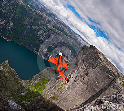 B.A.S.E. jumper in wingsuit  jumps at Kjerag Editorial Image