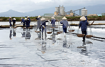 Group of saltworker carry salt at salina. BA RIA,  Editorial Photo