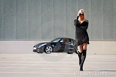 Babe near super car
