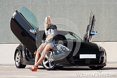 Babe near super car