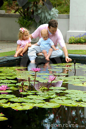 Free Babies Explore Water Lilies Royalty Free Stock Images - 4555799