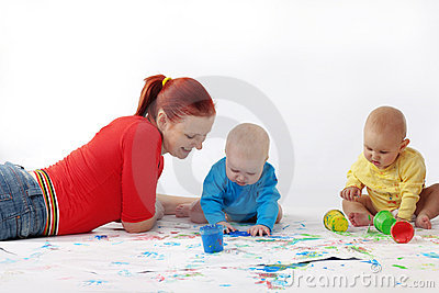 Babies painting with mother