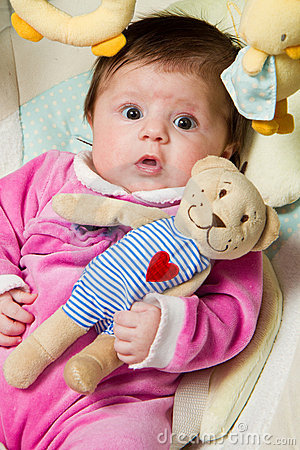 Baby with  ​​teddy bear