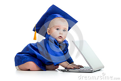 Baby in academician clothes using laptop