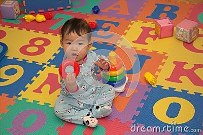 Baby on alphabet mat