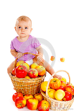 Baby on apple heap