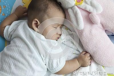 Baby asleep on bed