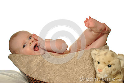Baby in the basket scratching gums
