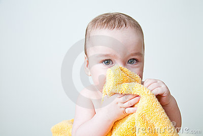 Baby After Bath Hiding Behind Yellow Towel