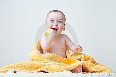 Baby After Bath Wrapped in Yellow Towel Sittin