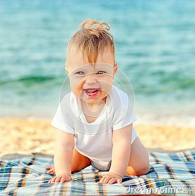 Baby On Beach. Summer Holidays Concept Stock Photo
