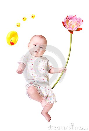 Baby with big flower and toy ducks isolated