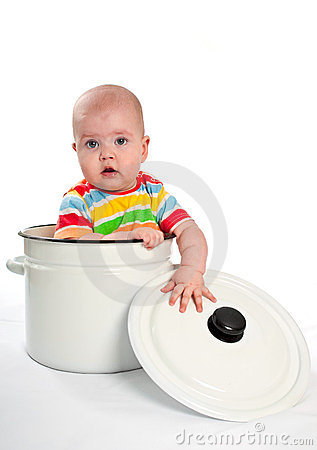 Baby in the big saucepan with cover