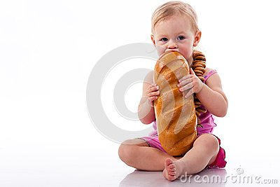 Baby biting a loaf of bread in roll beads