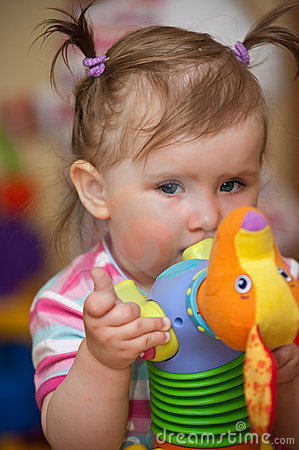 Baby biting on toy