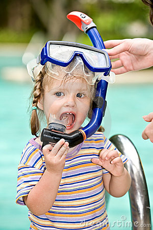 Baby in blue diver mask leaves pool.