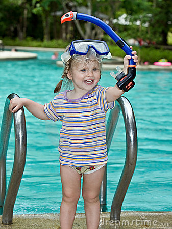 Baby in blue mask leaves pool.