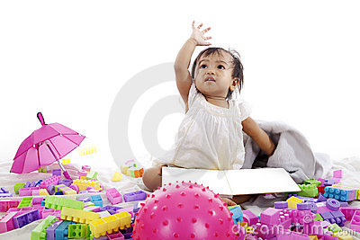 Baby with book and blocks