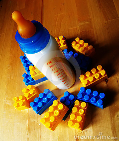 Free Baby Bottle And Toys Stock Photo - 1087600