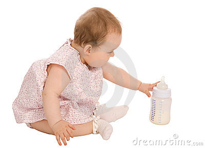 Baby and bottle with milk
