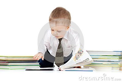 Baby boy with books over white