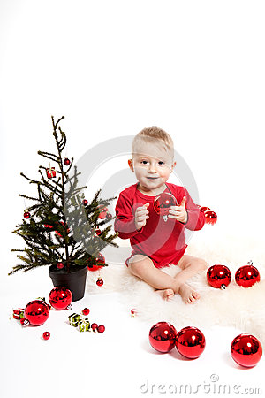 Baby boy with christmas tree