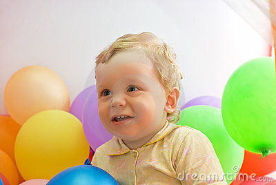 Baby boy with colorful balloons