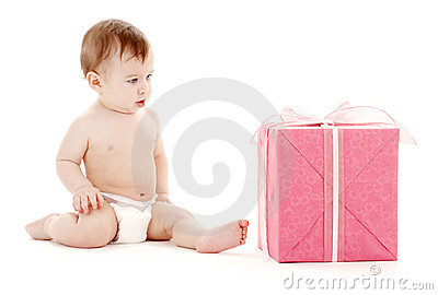 Baby boy in diaper with big gift box