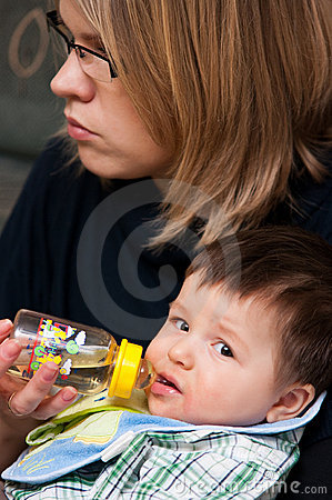 Baby boy drinks from bottle