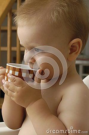 Baby boy drinks milk