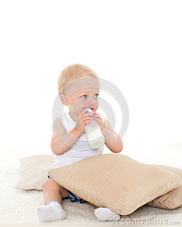 Free Baby Boy Drinks Milk From Bottle. Royalty Free Stock Images - 36574159
