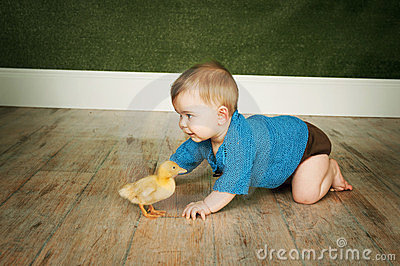 Baby boy with duck