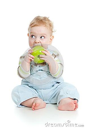 Baby boy eating healthy food