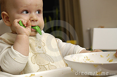Baby boy eats dinner