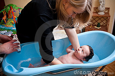 Baby boy having bath